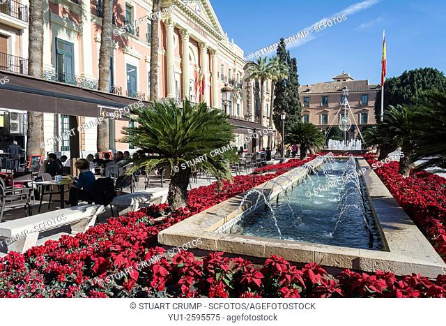 Poinsettia plants and water fountains in the Glorieta de Espana in Murcia Spain