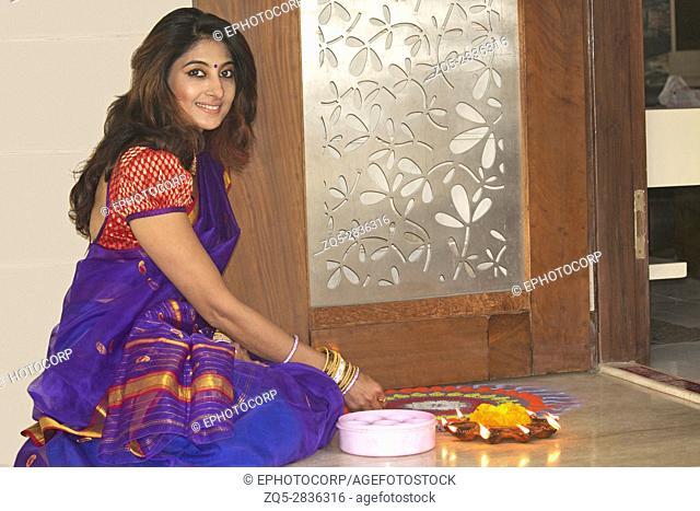 Hindu Indian lady in sari doing the aarti