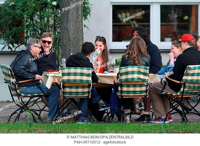 US actor George Clooney (L) attends a barbecue at the hotel 'Zu den Rothen Forellen' in Ilsenburg, Germany, 21 May 2013. US film star George Clooney is...