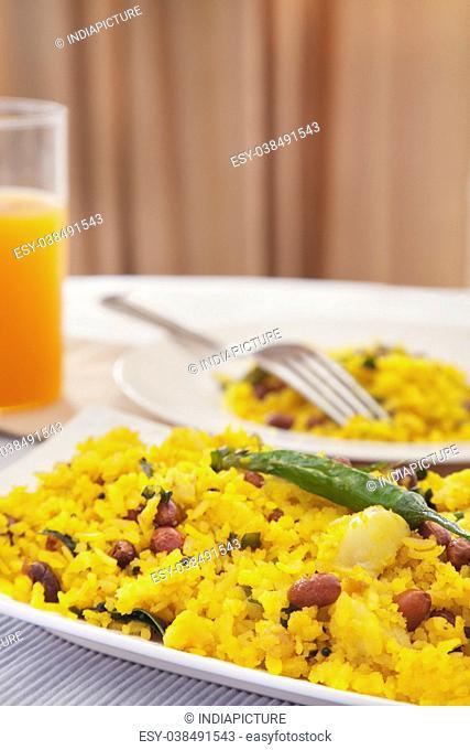Indian breakfast poha and juice