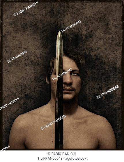A young man holding a sword