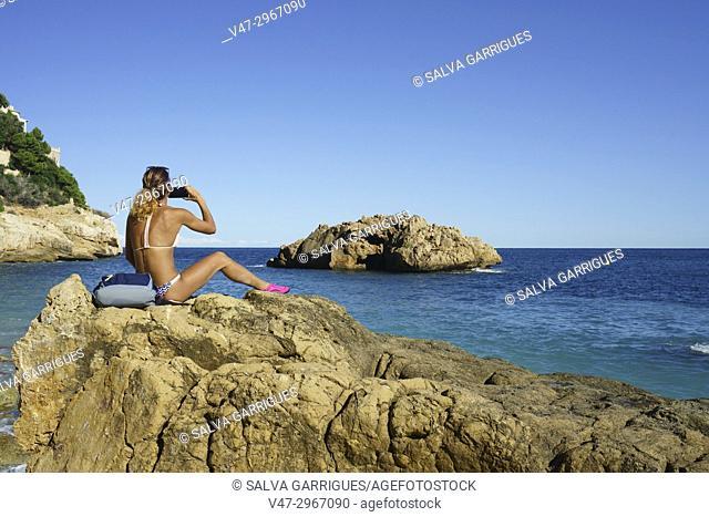 Holidaymakers in Ambolo Cove, Cabo la Nao, Javea, Alicante, Valencia, Spain, Europe