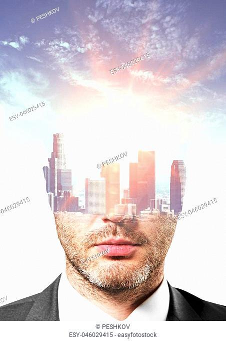 City headed businessman portrait on sky background. Double exposure
