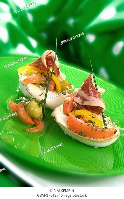 Cuttlefish with tomato, olives, and Iberian acorn ham vinaigrette