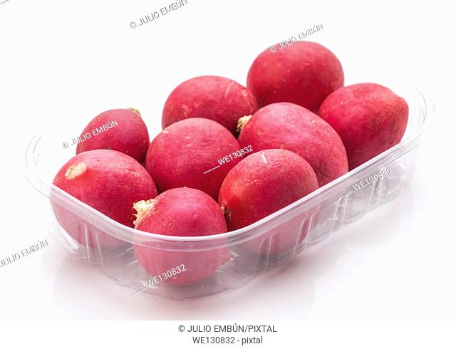 group of radishes in plastic container