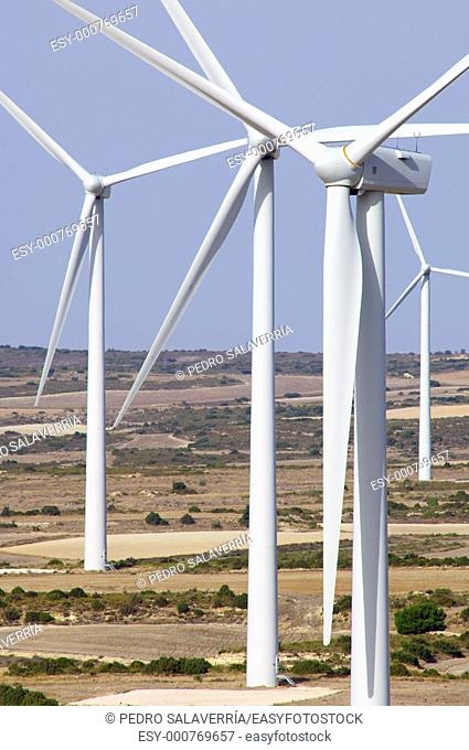 group of wind turbines in a steppe landscape with blue sky in Belchite, Saragossa, Aragon, Spain