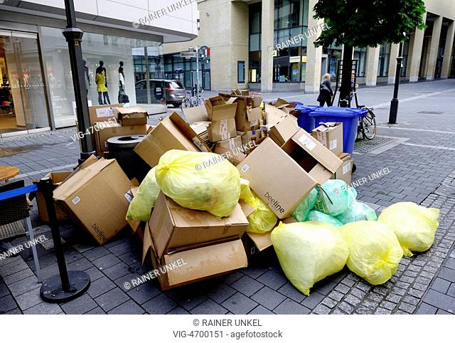 DEU , GERMANY : Recycling paper and Yellow Bags are waiting for collection in Bonn - Bonn, Northrhine-, Germany, 05/08/2014