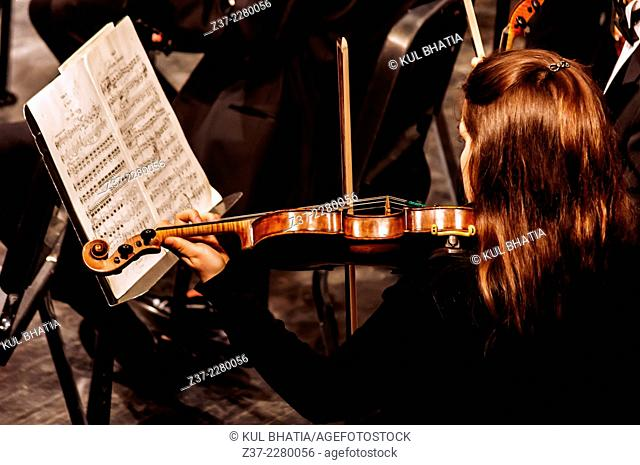 A young female violinist in concert, Ontario, Canada