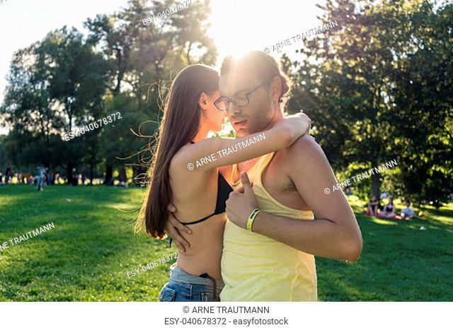 Dance couple training bachata in park in summer