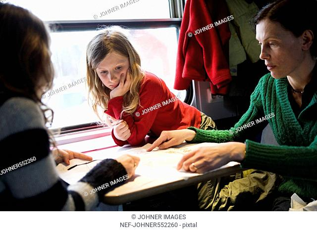 Mother and children on a train, Sweden