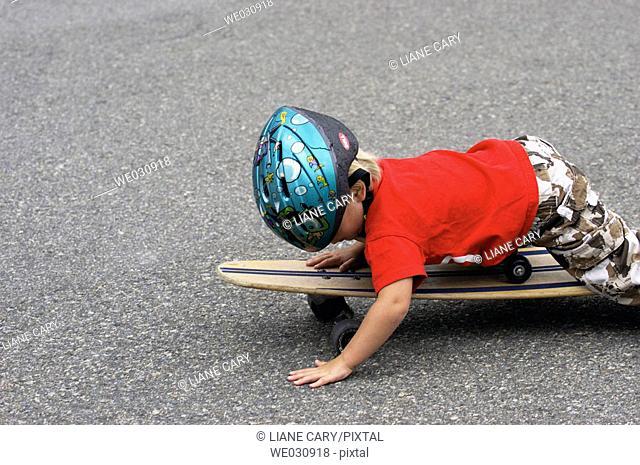 Boy lying on skateboard
