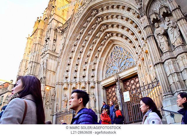 People in front of the Cathedral of the Holy Cross and Saint Eulalia, also known as Barcelona Cathedral. Gothic cathedral and seat of the Archbishop of...