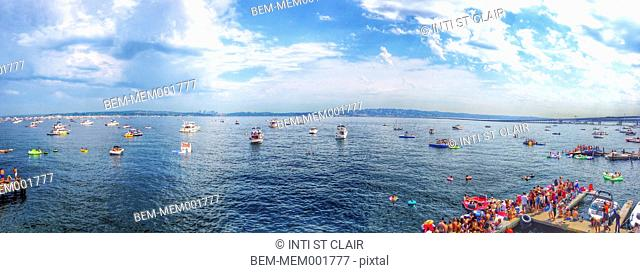 Panoramic view of boats floating on urban harbor