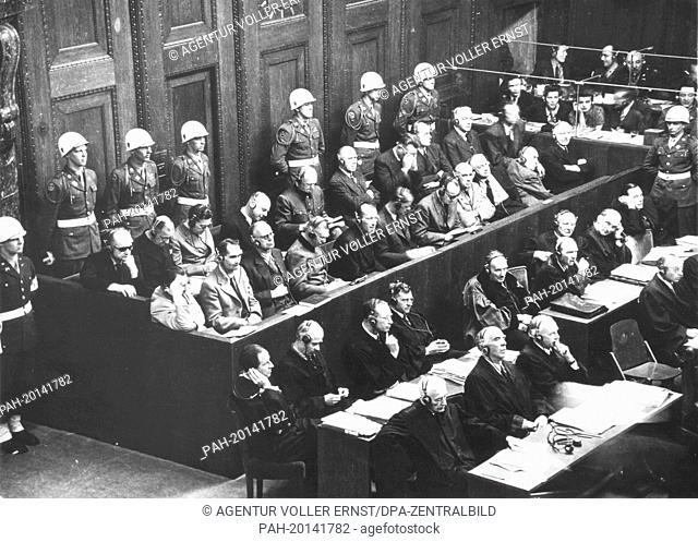 Main defendants as war criminals of the Nazi regime are surrounded by military policemen at the Nuremberg Trials in 1946. First row below from left