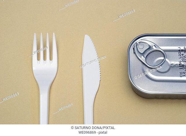 plastic cutlery and tin can