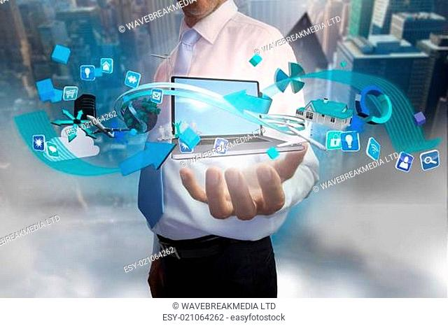 Businessman presenting app icons and laptop