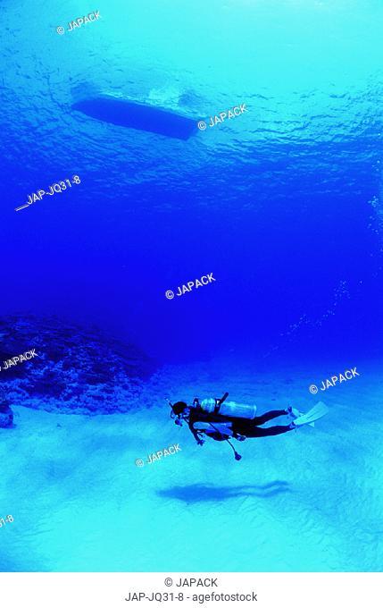 Scuba diver and boat