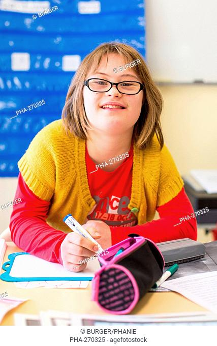 Teenage girl with Down syndrome 13 year old educated in ULIS (Localised Units for Inclusion School). Charente, France
