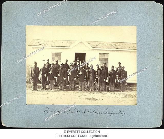 The Civil War, group of 21 African American men holding musical instruments, title: 'Band of 107th U.S. Colored Infantry', Arlington, Virginia