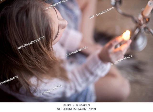 Girl igniting candles