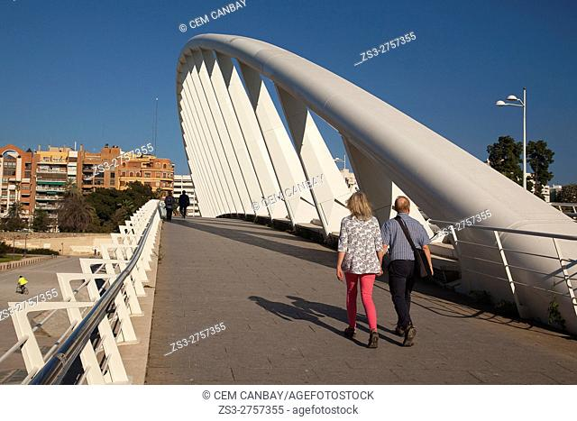 People walking on the Pont de l'Exposicion 'La Peineta' or 'Alameda Bridge' by Santiago Calatrava, in Jardi del Turia gardens, Valencia, Spain, Europe