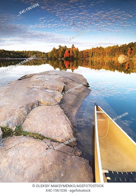 Canoe at a rocky shore of lake George  Beautiful sunset fall nature scenery  Killarney Provincial Park, Ontario, Canada