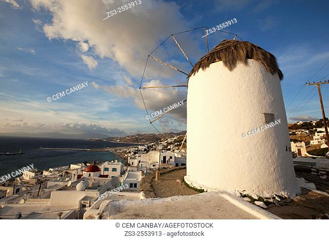 Windmill Bonis at the top of hill in town center with the port at the background, Mykonos, Cyclades Islands, Greek Islands, Greece, Europe