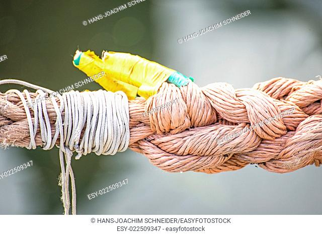 mooring line of a trawler with cracks