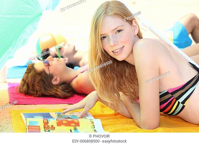 Three teenagers sunbathing together