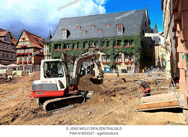 Public works are carried out during the reconstruction of the market square in Quedlinburg, Germany, 13 August 2013. By the end of the year the square will get...