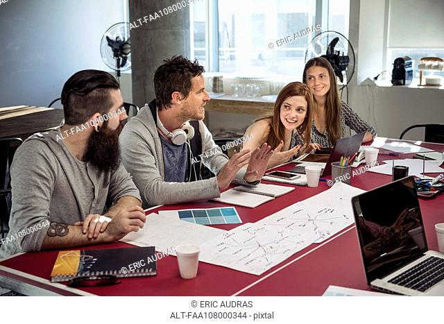 Creative professionals in casual meeting