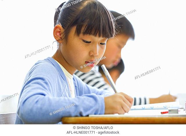 Japanese elementary school kid in the classroom