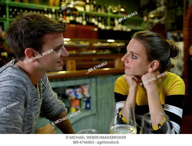 Young couple talking in Tapas Bar, San Cristobal de La Laguna, Tenerife, Canary Islands, Spain