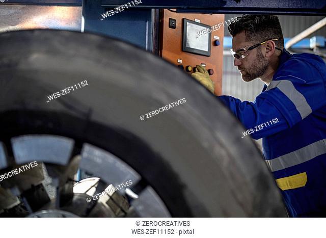 Repairman tuning tire with machine