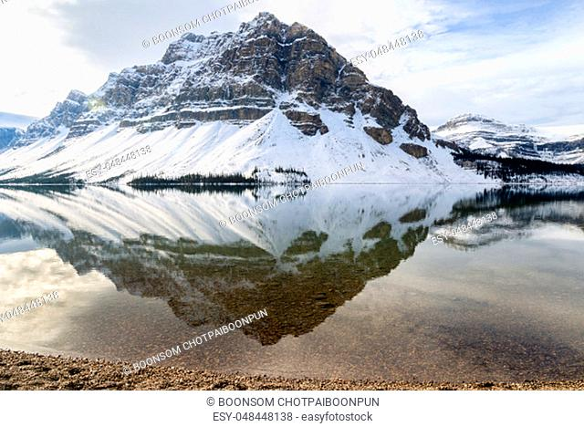 Scenic winter view of Bow Lake with Rocky mountain reflection in Banff National Park, Alberta, canada