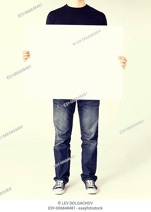 business and advertisement concept - man showing white blank board