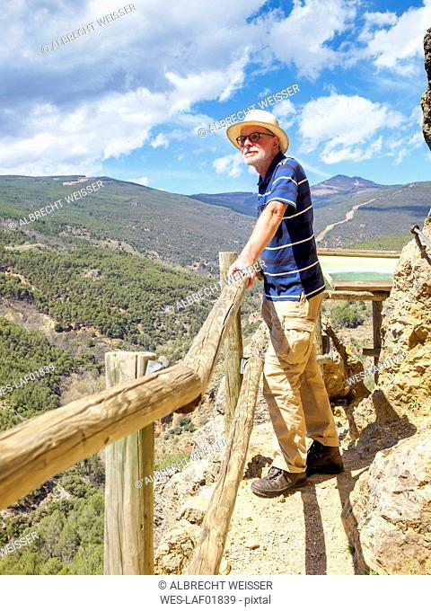 Spain, Sierra Nevada, Laujar de Andarax, senior man enjoying view