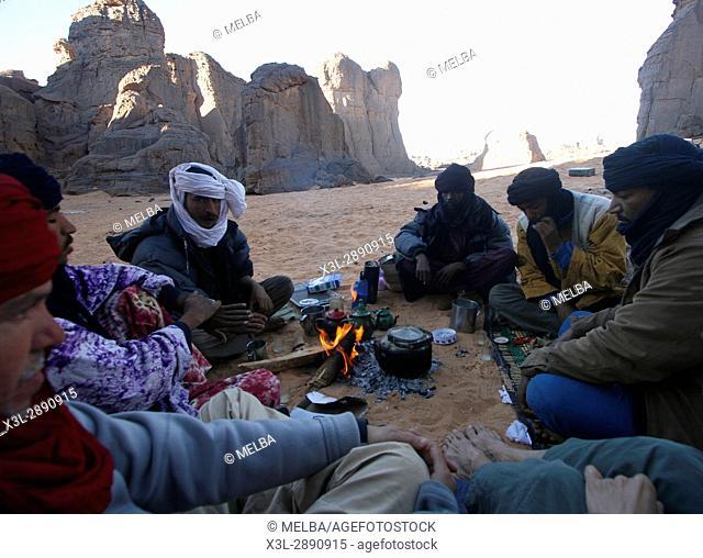 Tuaregs in campfire. El Ghessour. Tassili Ahaggar. Sahara desert. Algeria