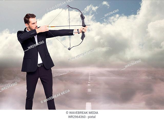 Side view of an archer shooting an arrow against road background