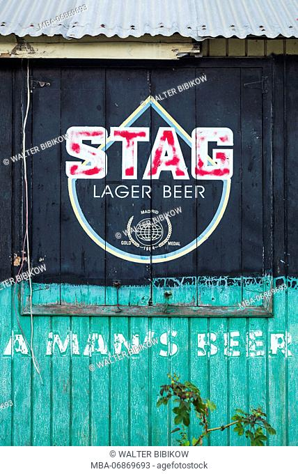 St. Kitts and Nevis, Nevis, Oualie Beach, shebeen, outdoor bar with sign for Stag beer