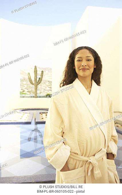 Hispanic woman in robe at resort, Los Cabos, Mexico