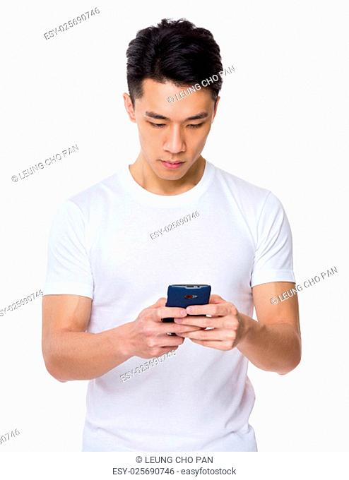 Asian young man use of the smartphone