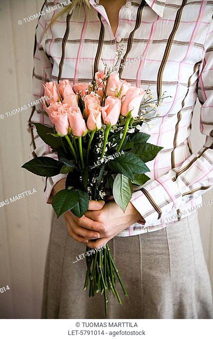 Woman with bunch of roses