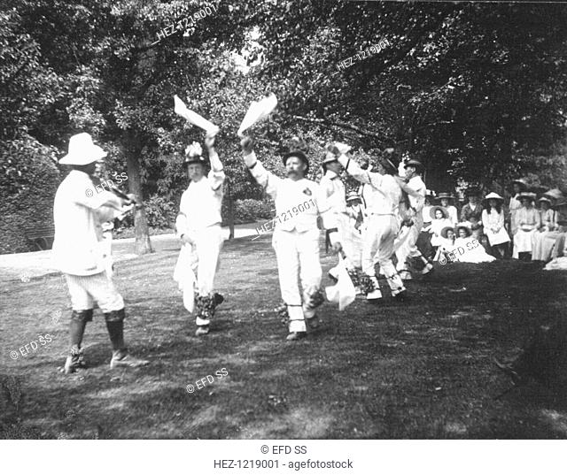 Bampton Morris Dancers, Oxfordshire, Whit Monday, 5 June 1911. William Nathan Wells playing the fiddle; Thomas Tanner and Joseph Rouse dancing