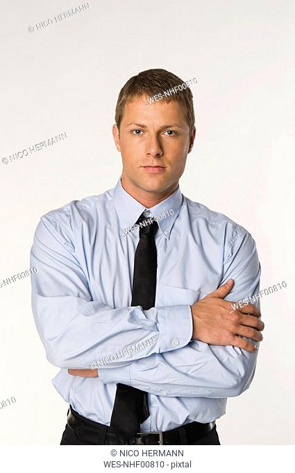 Businessman standing, arms folded