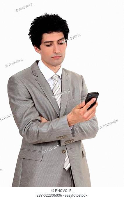 Businessman looking at his cellphone