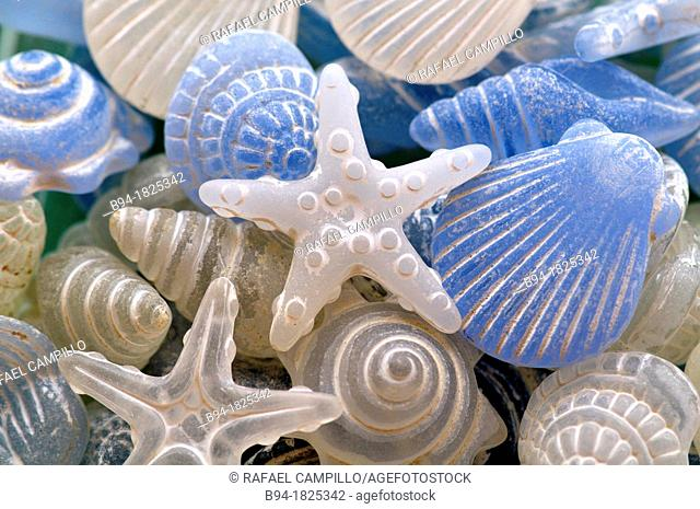 Glass decorative figures on marine elements such as starfish and shells
