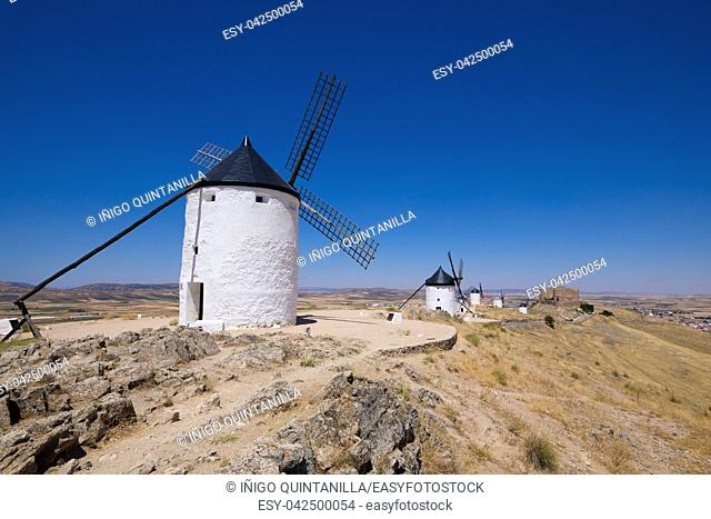 classic wind mills and ancient Castle in Consuegra town (Toledo, Castilla La Mancha, Spain). Built from the Sixteenth to the Nineteenth century