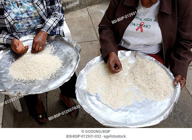OVC orphans & vulnerable children feeding program run by WOFAK Women Fighting Aids in Kenya. Meal preparation