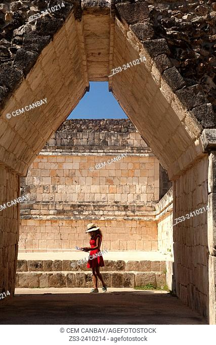 Woman going through an archway, Uxmal, Yucatan Province, Mexico, Central America